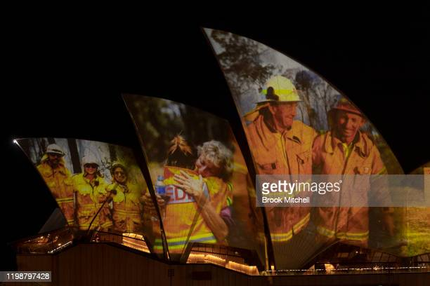 Images taken during the ongoing bushfire crisis are projected on the sails of the Sydney Opera House on January 11 2020 in Sydney Australia The...