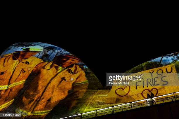 Images taken during the ongoing bushfire crisis are projected on the sails of the Sydney Opera House on January 11, 2020 in Sydney, Australia. The...