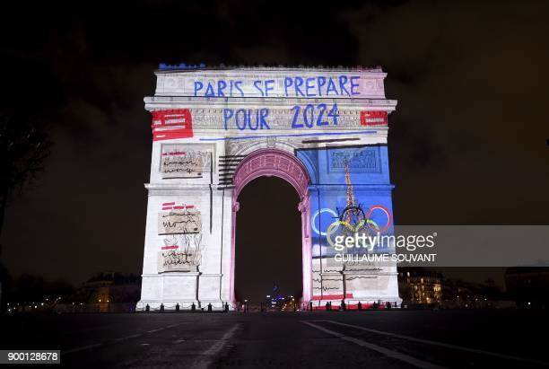 Images with a slogan reading 'Paris is getting ready for 2024' refering to the 2024 Olympic Games that Paris was awarded are projected on the Arc de...