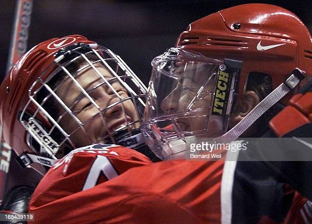 Team Canada's Cassie Campbell hugs teamate Jayna Hefford after Cassie scored the fifth goal in the first period against China during second round...