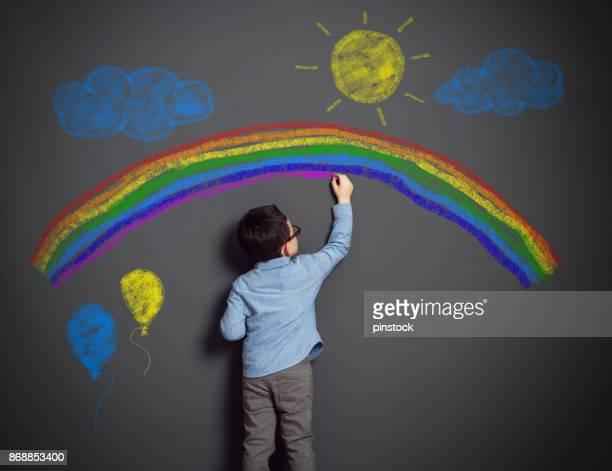 imagination of little child - arcobaleno foto e immagini stock