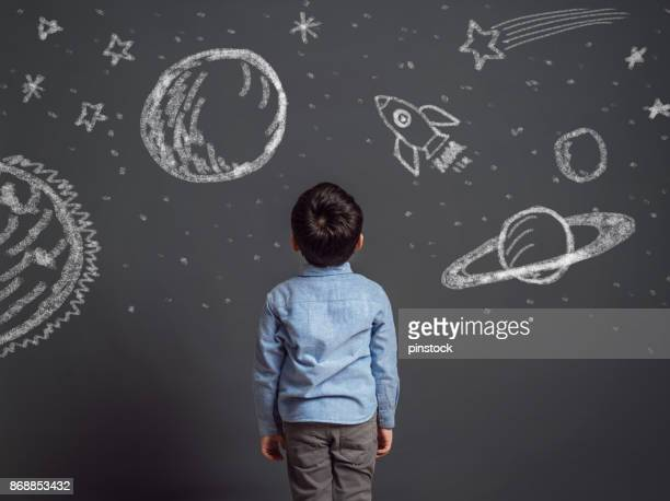 imagination of little child - blackboard stock photos and pictures
