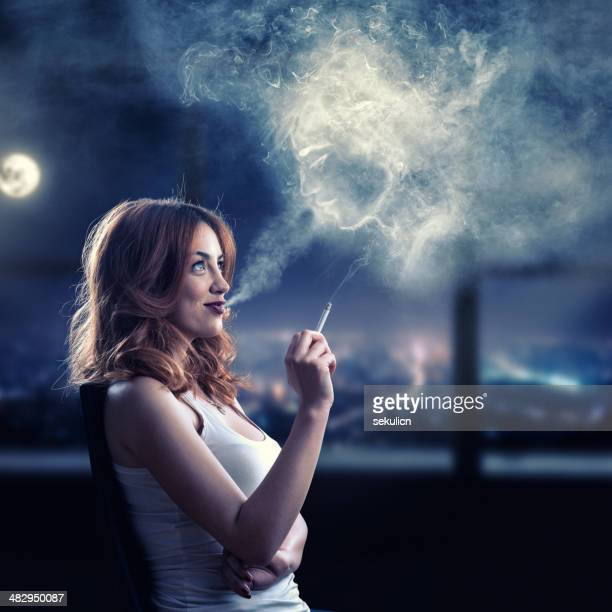 imagination - beautiful women smoking cigarettes stock photos and pictures