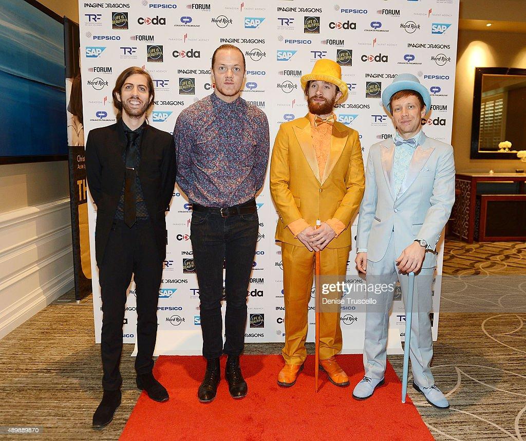 Imagine Dragons guitarist Wayne 'Wing' Sermon, lead vocalist Dan Reynolds, drummer Daniel Platzman and bassist Ben McKee arrive at the 'Imagine a World Without Cancer' gala at the Four Seasons Hotel Las Vegas on September 24, 2015 in Las Vegas, Nevada.