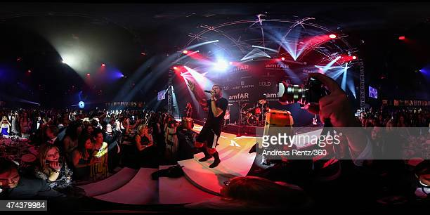 Imagine Dragons perform during amfAR's 22nd Cinema Against AIDS Gala Presented By Bold Films And Harry Winston at Hotel du CapEdenRoc on May 21 2015...