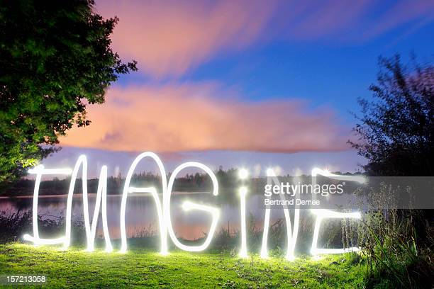 'Imagine' written in light