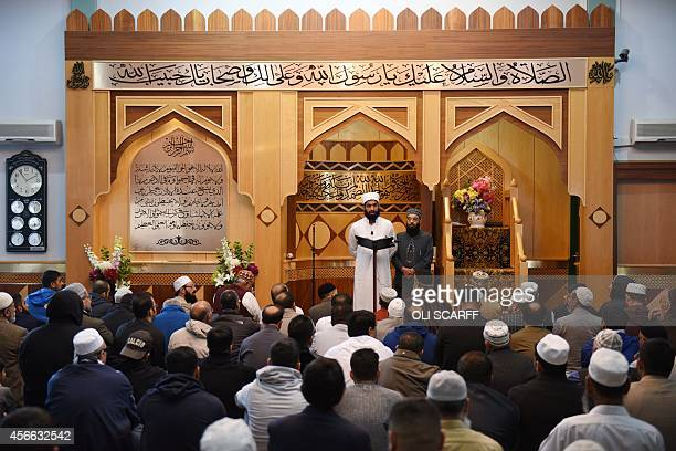 Imam Asim Hussain reads a prayer for murdered aid worker Alan Henning in Manchester Central Mosque in Manchester north west England on October 4 2014...