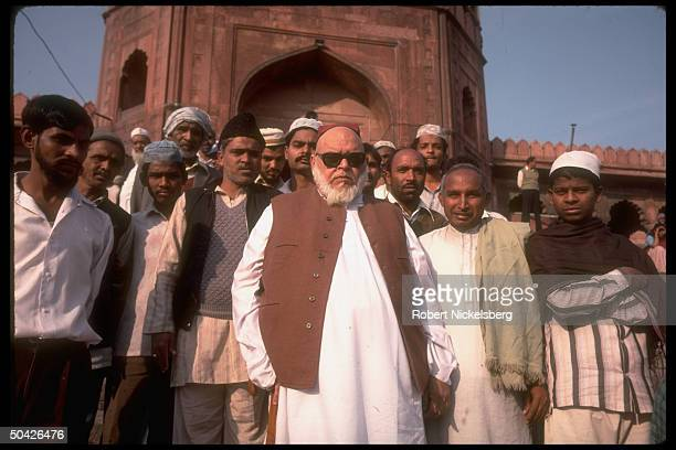 Imam Bukhari w Moslems outside during Fri prayer services at Jama Masjid Mosque in old Delhi