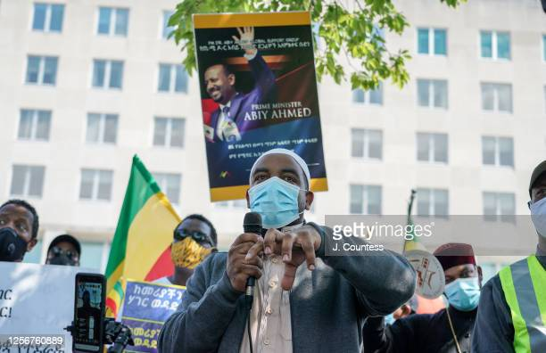 Imam Doyl speaks to activist and members of the Ethiopian community representing multiple ethnic groups during a protest to support Ethiopian Prime...