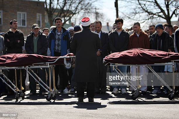 Imam Kasim Kopuz of the Islamic Organization of the Southern Tier leads funeral prayers for two victims of a recent mass shooting in nearby...