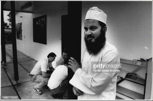 Imam Nazir Ul Hassan Thanvi stands outside his mosque at Rooty Hill after it was fire bombed as scientific police look for clues.Imam Hasan Thahnui...