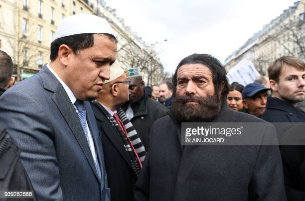 TOPSHOT Imam of Drancy Hassen Chalghoumi and FrenchJewish writer Marek Halter prepare to take part in a silent march in Paris on March 28 in memory...