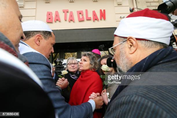 Imam of Drancy Hassen Chalghoumi and other members of religious communities speak together and with other people in front of the Bataclan concert...