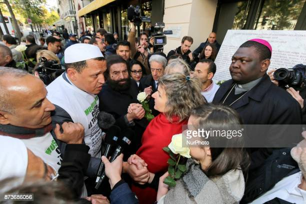 Imam of Drancy Hassen Chalghoumi French writer Marek Halter and other members of religious communities speak together and with other people in front...