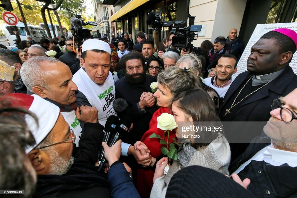Members of religious communities speak in front of  the Bataclan concert in Paris