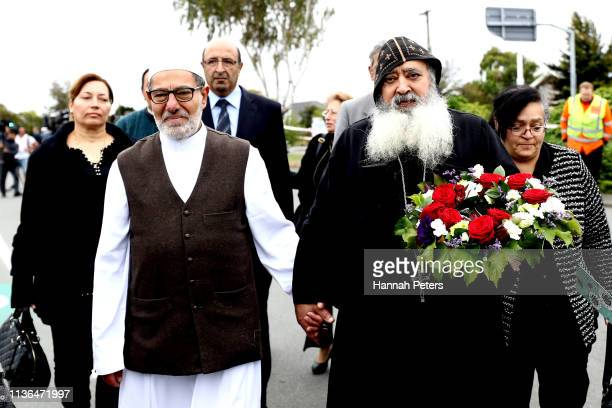 Imam of the attacked Linwood Mosque Ibrahim Abdul Halim walks with Father Felimoun ElBaramoussy priest at St Michael the Archangel Antiochian...