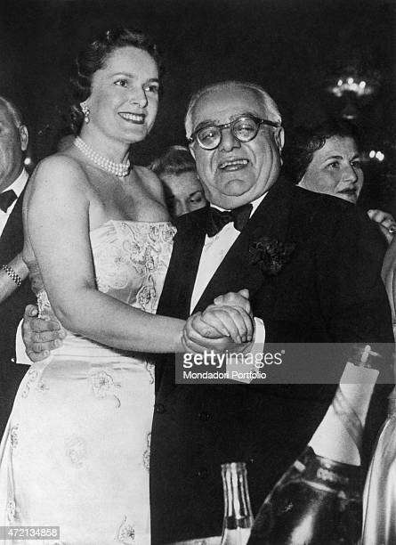 Imam of the Nizari Ismaili community Aga Khan III dancing with his wife Begum Om Habibeh Aga Khan during New Year's Eve The French model wears a...