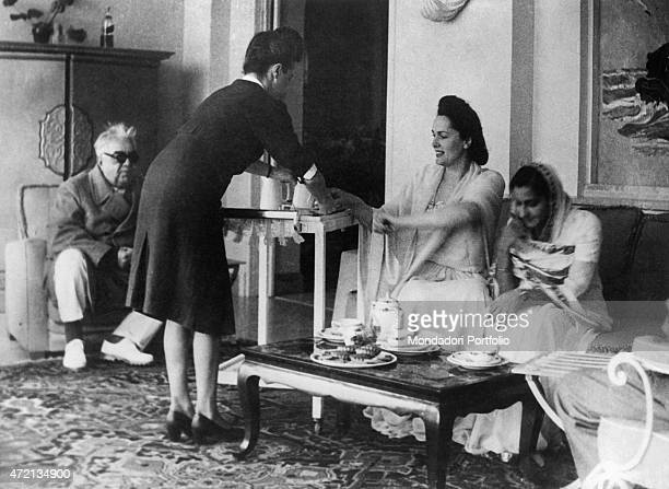 Imam of the Nizari Ismaili community Aga Khan III receiving an Indian princess with his wife French model Begum Om Habibeh Aga Khan 1950s
