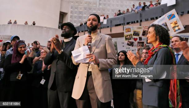 Imam Omar Suleiman speaks flanked by Dr Michael W Watson left and Rabbi Nancy Kasten all from Faith Forward at a vigil for refugees on Monday Jan 30...