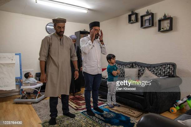 Imam Raza Ahmed his brother Rizwan wife Anam and two sons Daniel and Daud complete the fourth prayer of the day known as maghrib at their family home...