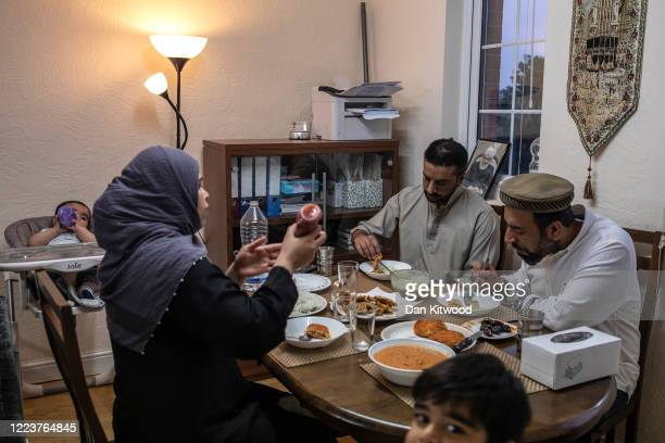 Imam Raza Ahmed his brother Rizwan wife Anam and two sons Daniel and Daud take iftar the fastbreaking meal after sunset at their family home on May...