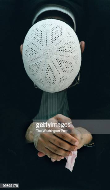 Imam Sheikh Anwar AlAwlaki of the Dar Al Hijrah muslim mosque prays during a community press conference/prayer service on Septembe 12 2001 in Falls...