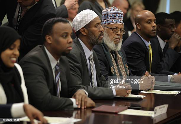 Imam Sheikh Sa'ad Musse Roble President of World Peace Organization in Minneapolis MN and other city representatives listen during a roundtable...