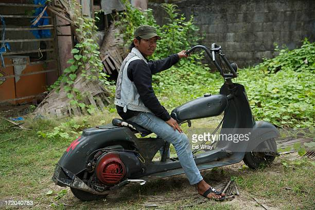Imam sits in his extreme vespa modification during a scooter festival on June 30 2013 in Cibeureum about 100 km west of Jakarta Indonesia Hundreds of...