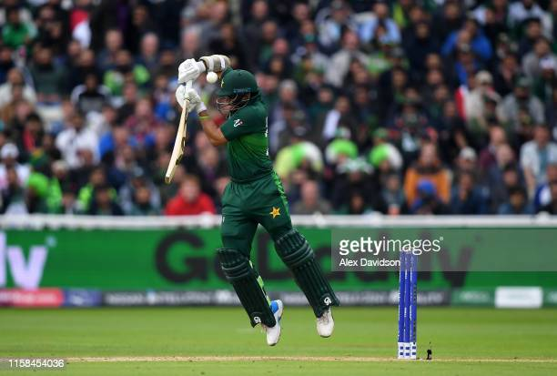 Imam Ul Haq of Pakistan plays a shot into the air which is caught by Martin Guptill of New Zealand during the Group Stage match of the ICC Cricket...