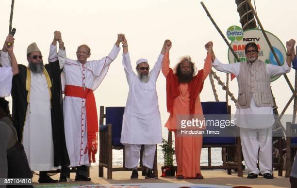 Imam Umer Ahmed Ilyasi Oswald Cardinal Gracias Mahmood A Madani Swami Chidanand Saraswati and actor Amitabh Bachchan participate during Banega Swachh...