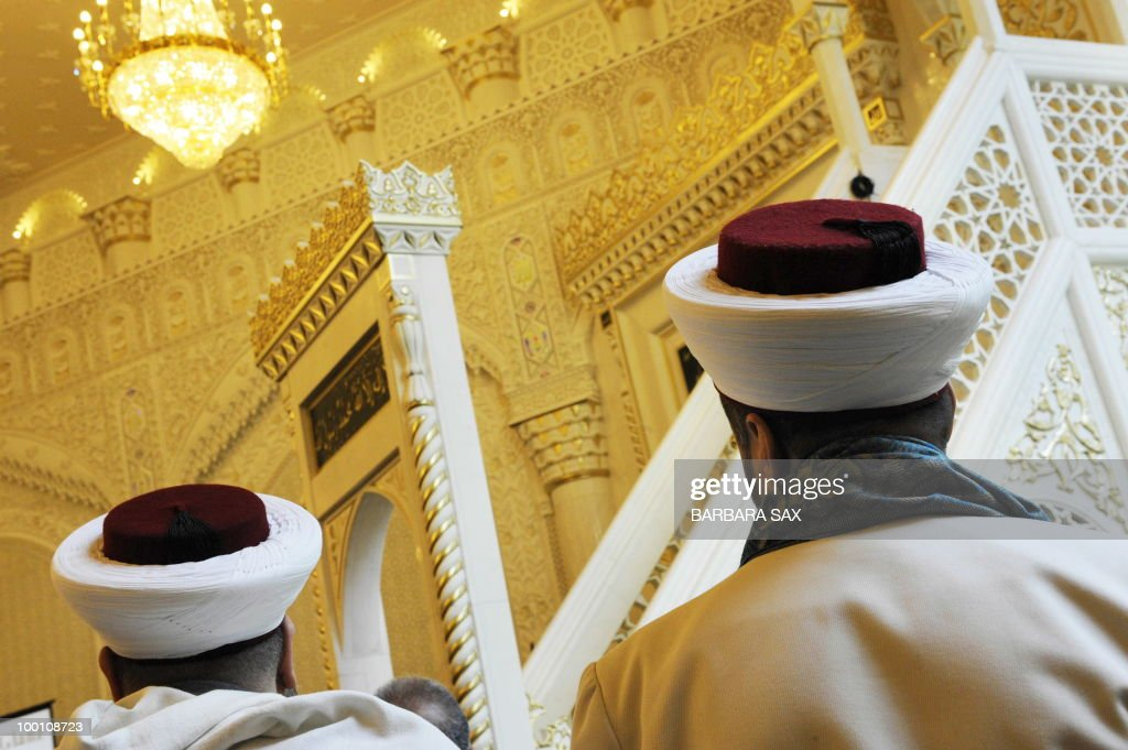 Imams attend a service to inaugurate the
