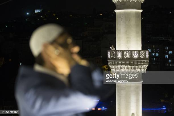 Imams recite prayer from a minaret of a mosque during July 15 Democracy and National Unity Day's events to mark July 15 defeated coup's 1st...