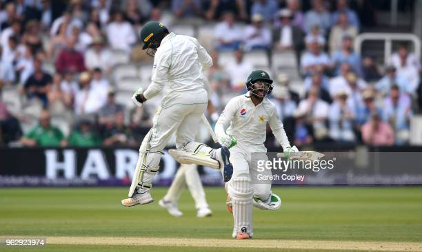 ImamulHaq and Haris Sohail of Pakistan celebrate winning the 1st NatWest Test match at Lord's Cricket Ground on May 27 2018 in London England
