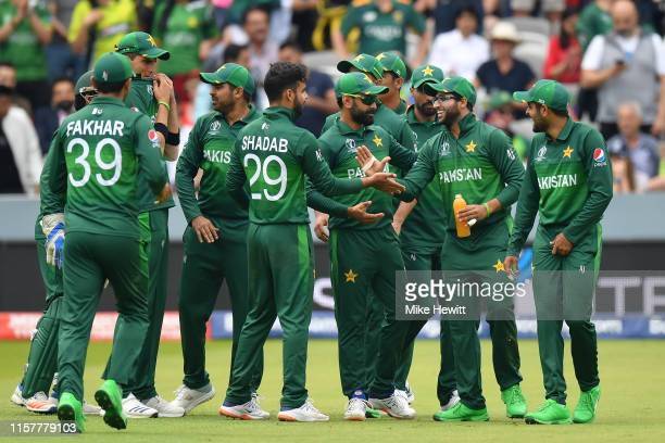 Imam-Ul-Haq of Pakistan celebrates with team mates after taking the catch to dismiss Quinton de Kock of South Africa during the Group Stage match of...