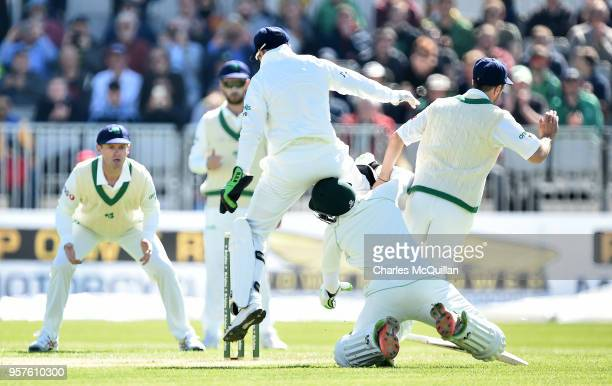 ImamulHaq of Pakistan collides with Tyrone Kane of Ireland during the opening bowl of the Ireland v Pakistan test cricket match on May 12 2018 in...