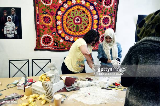 Iman Al Bohtori a 22year old Damascus University graduate participates in a sculpting workshop taught by an Albanian poet living in Greece at the...