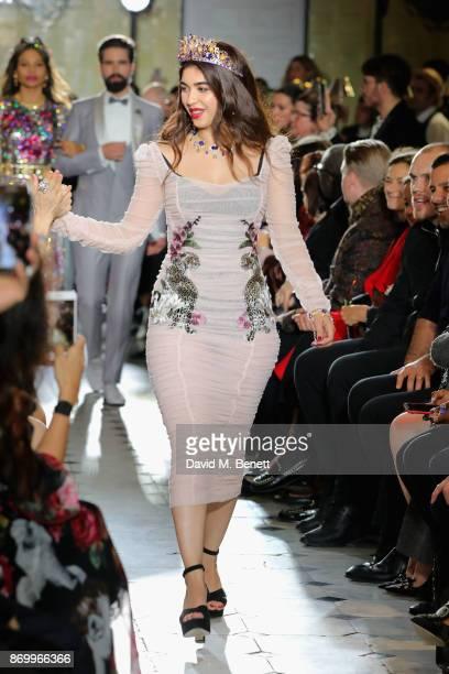 Iman Allana walks the Dolce Gabbana Italian Christmas catwalk show at Harrods on November 2 2017 in London England