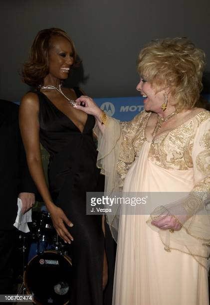 Iman and Dame Elizabeth Taylor during Cannes 2002 amfAR's Cinema Against AIDS Gala sponsored by Motorola and cosponsored by De Beers Auction at Le...