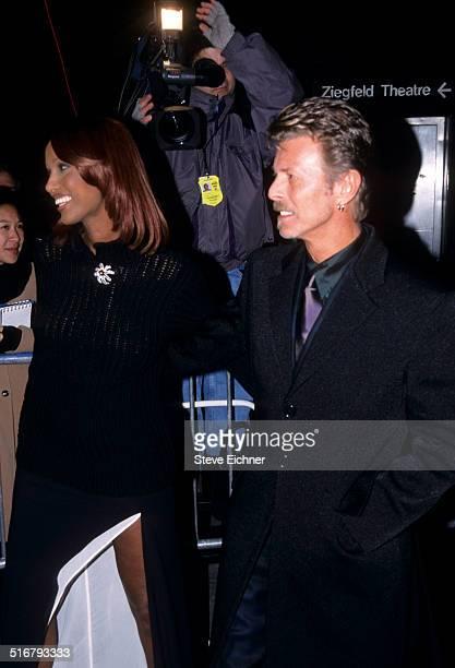 Iman and David Bowie at premiere of Meet Joe Black at Ziegfeld Theater New York November 2 1998