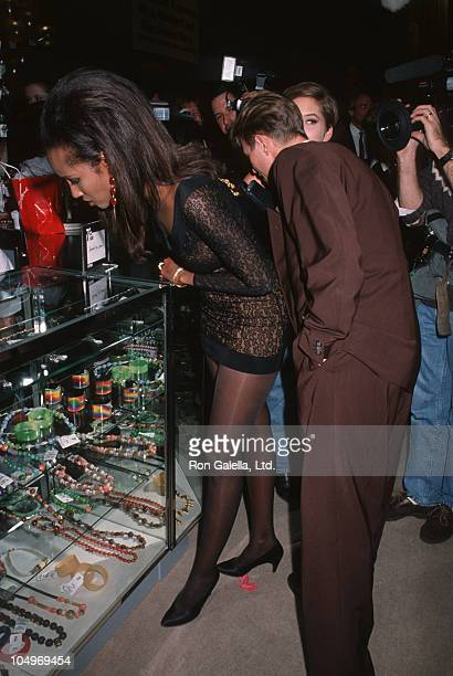 """Iman and David Bowie during """"7th On Sale"""" To Benefit AIDS Research - November 29, 1990 at 69th Regiment Armory in New York City, New York, United..."""