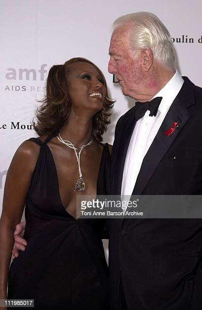 Iman & Hubert de Givenchy during Cannes 2002 - amfAR's Cinema Against AIDS Gala sponsored by Motorola and co-sponsored by De Beers - Arrivals at Le...
