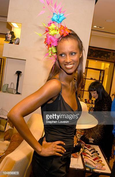 Iman in a hat by Philip Treacy during Philip Treacy Shows His Spring 2003 Hat Collection at Bergdorf's at Bergdorf Goodman in New York City, NY,...