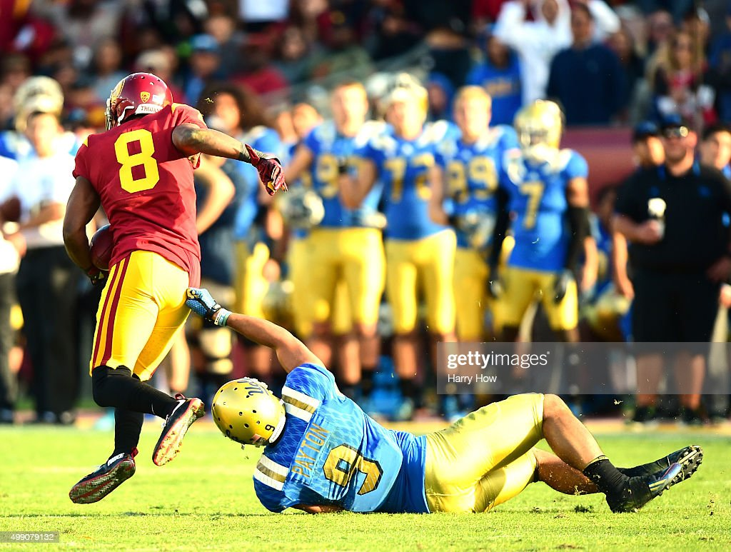Iman Marshall #8 of the USC Trojans makes an interception in front of a Jordan Payton #9 of the UCLA Bruins during a 40-21 Trojan win at Los Angeles Memorial Coliseum on November 28, 2015 in Los Angeles, California.