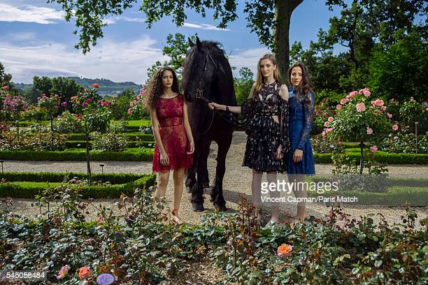 Iman Perez Mathilde Pinault and Flore Giraud are photographed for Paris Match with a horse called Le Frison in the Bagatelle gardens on June 22 2016...