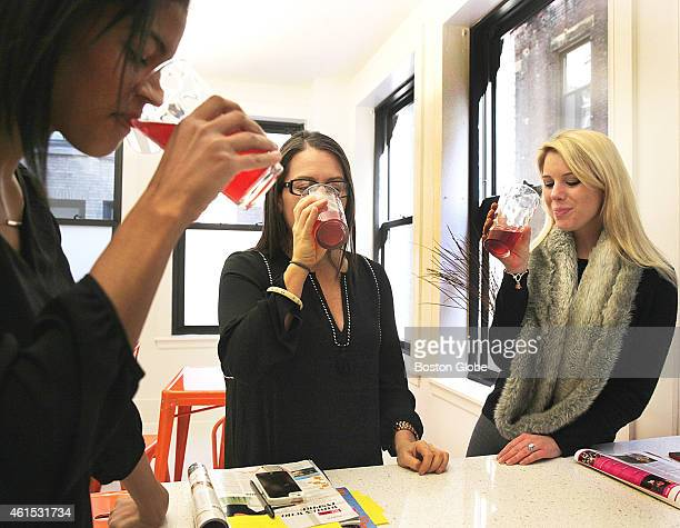 Iman Richards left Kerri Axelrod center and Abby Steinbock right took a kombucha break at Marlo Marketing in Boston on January 9 2015