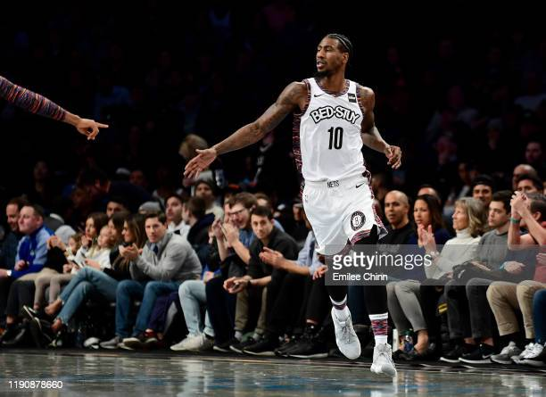 Iman Shumpert of the Brooklyn Nets celebrates after his three pointer during the first half of their game against the Boston Celtics at Barclays...