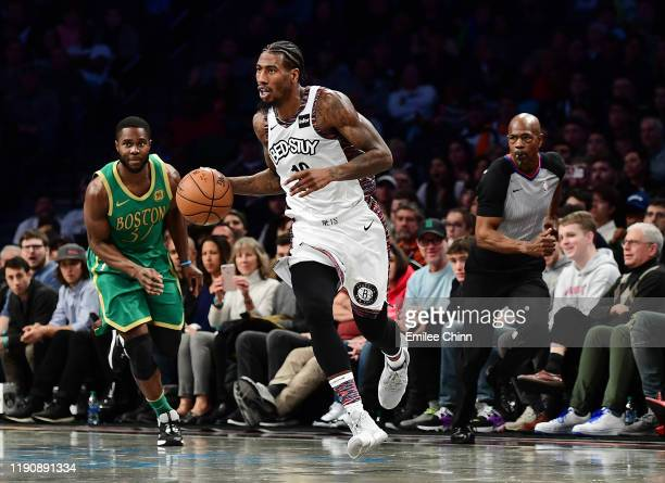 Iman Shumpert of the Brooklyn Nets drives past Semi Ojeleye of the Boston Celtics during the second half of their game at Barclays Center on November...