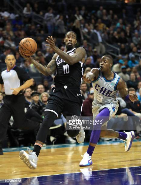 Iman Shumpert of the Brooklyn Nets drives to the basket against Terry Rozier of the Charlotte Hornets during their game at Spectrum Center on...