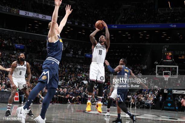 Iman Shumpert of the Brooklyn Nets shoots the ball during a game against the Denver Nuggets on December 8 2019 at Barclays Center in Brooklyn New...