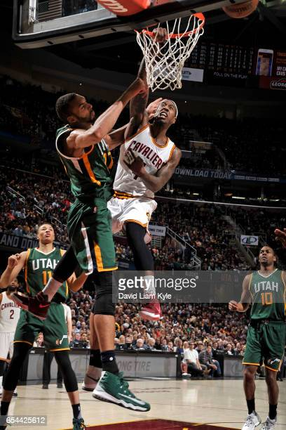 Iman Shumpert of the Cleveland Cavaliers dunks the ball over Rudy Gobert of the Utah Jazz during the game on March 16 2017 at Quicken Loans Arena in...